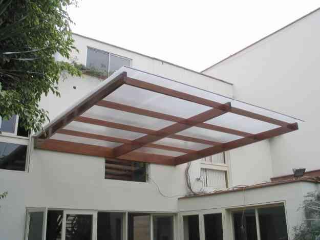 Policarbonato techos corredizos terrazas patios cocheras for Casas de madera para patios